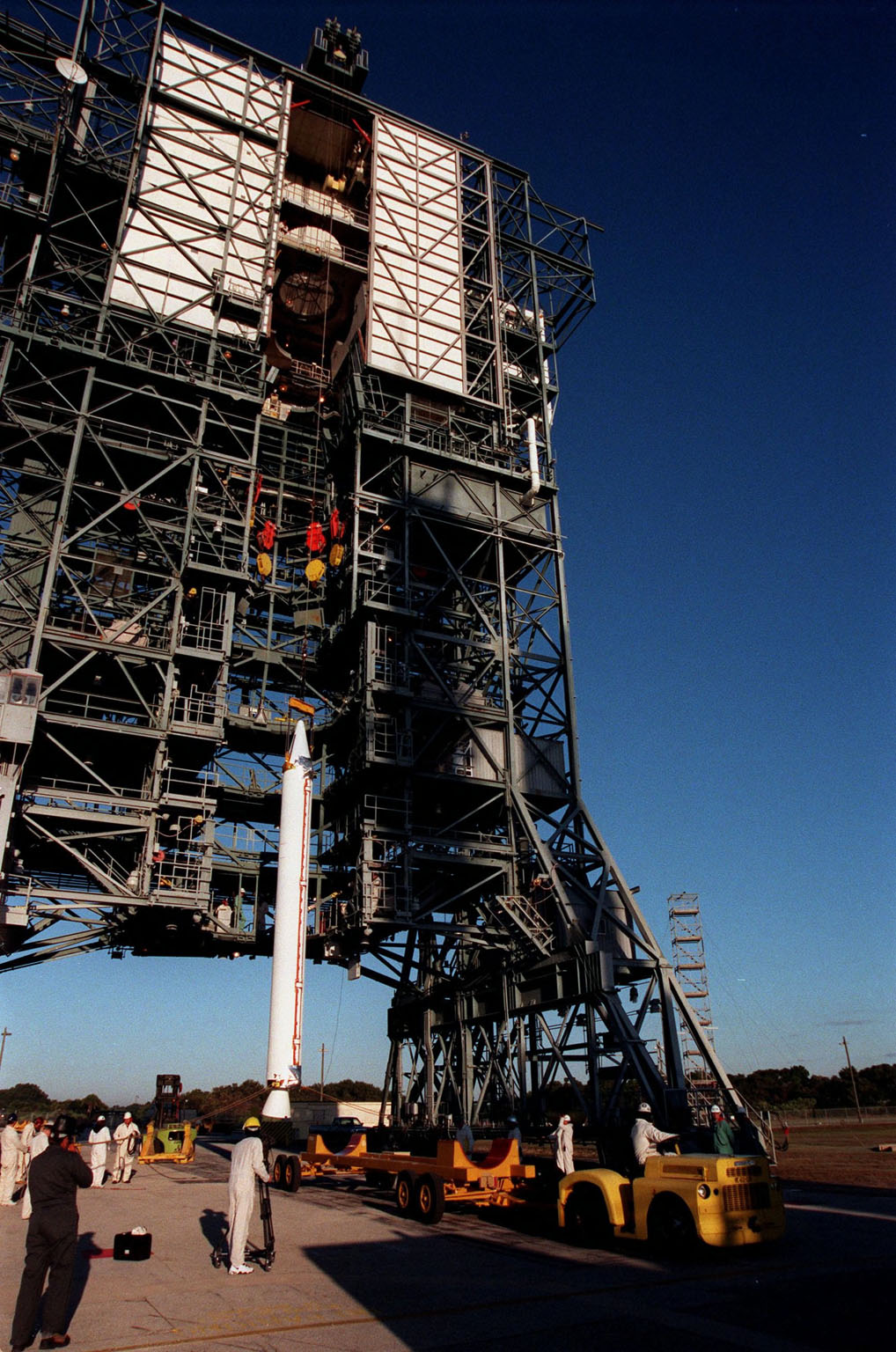 A fourth and final Solid Rocket Booster, to be mated with a Boeing Delta II rocket, starts its lift up the tower at Pad 17A, Cape Canaveral Air Station. The rocket will carry the Stardust satellite into space for a close encounter with the comet Wild 2 in January 2004. Using a medium called aerogel, Stardust will capture comet particles flying off the nucleus of the comet, plus collect interstellar dust for later analysis. The collected samples will return to Earth in a Sample Return Capsule to be jettisoned as Stardust swings by Earth in January 2006. Stardust is scheduled to be launched on Feb. 6, 1999