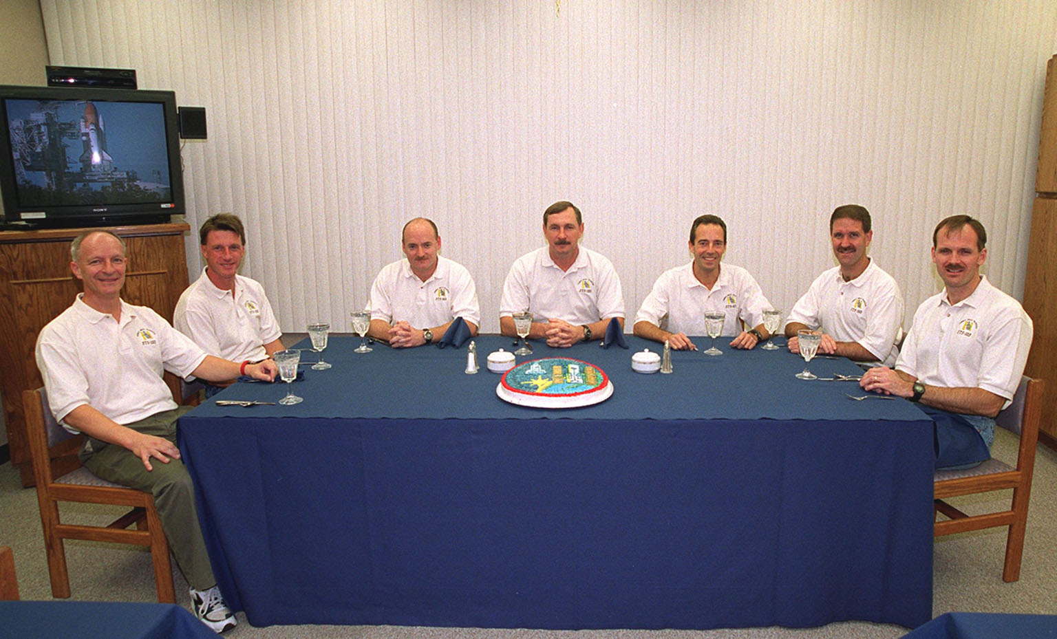 For the second time in two days, the STS-103 crew have breakfast before suiting up for launch. From left are Mission Specialists Claude Nicollier of Switzerland and C. Michael Foale (Ph.D.), Pilot Scott J. Kelly, Commander Curtis L. Brown Jr., and Mission Specialists Jean-Francois Clervoy of France, John M. Grunsfeld (Ph.D.) and Steven L. Smith. Nicollier and Clervoy are with the European Space Agency. The previous launch attempt on Dec. 17 was scrubbed about 8:52 p.m. due to numerous violations of weather launch commit criteria at KSC. The mission, to service the Hubble Space Telescope, is now scheduled for launch Dec. 19 at 7:50 p.m. EST from Launch Pad 39B. Mission objectives include replacing gyroscopes and an old computer, installing another solid state recorder, and replacing damaged insulation in the telescope. After the 7-day, 21-hour mission, Discovery is expected to land at KSC Monday, Dec. 27, at about 5:24 p.m. EST