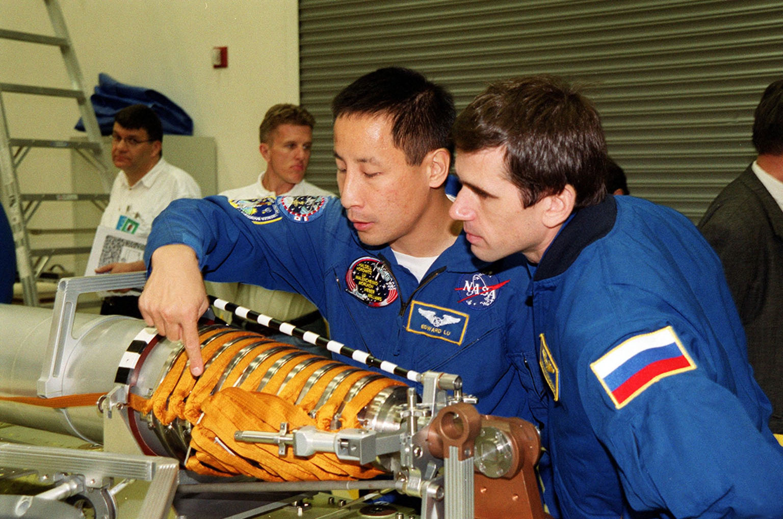KENNEDY SPACE CENTER, FLA. -- During a Crew Equipment Interface Test (CEIT) at SPACEHAB, in Cape Canaveral, Fla., STS-101 crew members Edward Tsang Lu (Ph.D.) and Yuri Malenchenko, who is with the Russian Space Agency (RSA) check out part of the Russian crane Strela. Other crew members are Commander James Donald Halsell Jr., Pilot Scott Horowitz, and Mission Specialists Jeffrey N. Williams, Mary Ellen Weber, (Ph.D.) and Boris W. Morukov, also with RSA. The primary objective of the STS-101 mission is to complete the initial outfitting of the International Space Station, making it fully ready for the first long-term crew. The seven-member crew will transfer almost two tons of equipment and supplies from SPACEHAB's Logistics Double Module. Additionally, they will unpack a shipment of supplies delivered earlier by a Russian Progress space tug and begin outfitting the newly arrived Zvezda Service Module. Three astronauts will perform two space walks to transfer and install parts of the Russian Strela cargo boom that are attached to SPACEHAB's Integrated Cargo Container, connect utility cables between Zarya and Zvezda, and install a magnetometer/pole assembly on the Service Module. Additional activities for the STS-101 astronauts include working with the Space Experiment Module (SEM-06) and the Mission to America's Remarkable Schools (MARS), two educational initiatives. STS-101 is scheduled for launch no earlier than March 16, 2000