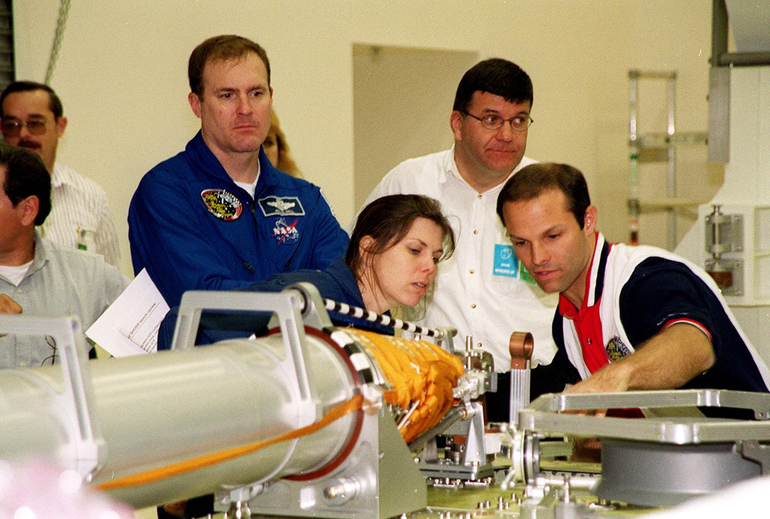 KENNEDY SPACE CENTER, FLA. -- During a Crew Equipment Interface Test (CEIT), members of the STS-101 crew learn about some of the cargo that will be on their mission from workers at SPACEHAB, in Cape Canaveral, Fla. At left are Commander James Donald Halsell Jr., and Mission Specialist Mary Ellen Weber, (Ph.D.). Other crew members are Pilot Scott Horowitz, and Mission Specialists Edward Lu, Jeffrey N. Williams, and Boris W. Morukov and Yuri Malenchenko, who are with the Russian Space Agency. The primary objective of the STS-101 mission is to complete the initial outfitting of the International Space Station, making it fully ready for the first long-term crew. The seven-member crew will transfer almost two tons of equipment and supplies from SPACEHAB's Logistics Double Module. Additionally, they will unpack a shipment of supplies delivered earlier by a Russian Progress space tug and begin outfitting the newly arrived Zvezda Service Module. Three astronauts will perform two space walks to transfer and install parts of the Russian Strela cargo boom that are attached to SPACEHAB's Integrated Cargo Container, connect utility cables between Zarya and Zvezda, and install a magnetometer/pole assembly on the Service Module. Additional activities for the STS-101 astronauts include working with the Space Experiment Module (SEM-06) and the Mission to America's Remarkable Schools (MARS), two educational initiatives. STS-101 is scheduled for launch no earlier than March 16, 2000