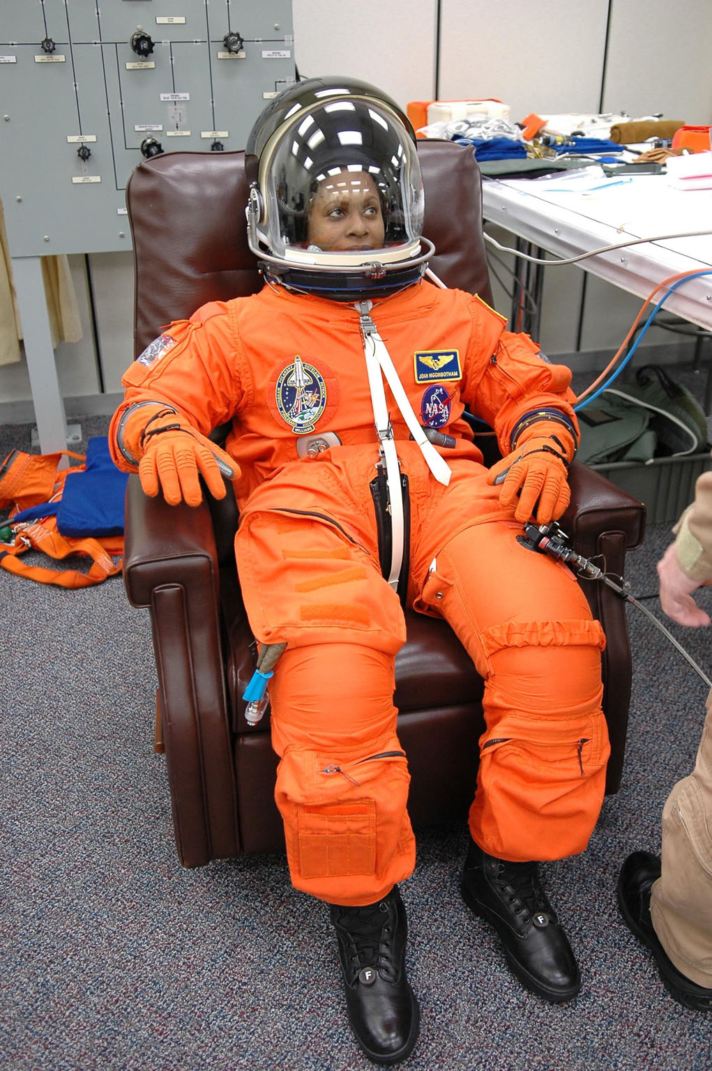 KENNEDY SPACE CENTER, FLA. -- STS-116 Mission Specialist Joan Higginbotham has donned her complete launch suit to check the fit, part of the prelaunch preparations during terminal countdown demonstration test (TCDT) activities. The mission crew is at KSC for the TCDT, which includes a simulated launch countdown. The STS-116 mission is No. 20 to the International Space Station and construction flight 12A.1. The mission payload is the SPACEHAB module, the P5 integrated truss structure and other key components. Launch is scheduled for no earlier than Dec. 7. Photo credit: NASA/Kim Shiflett
