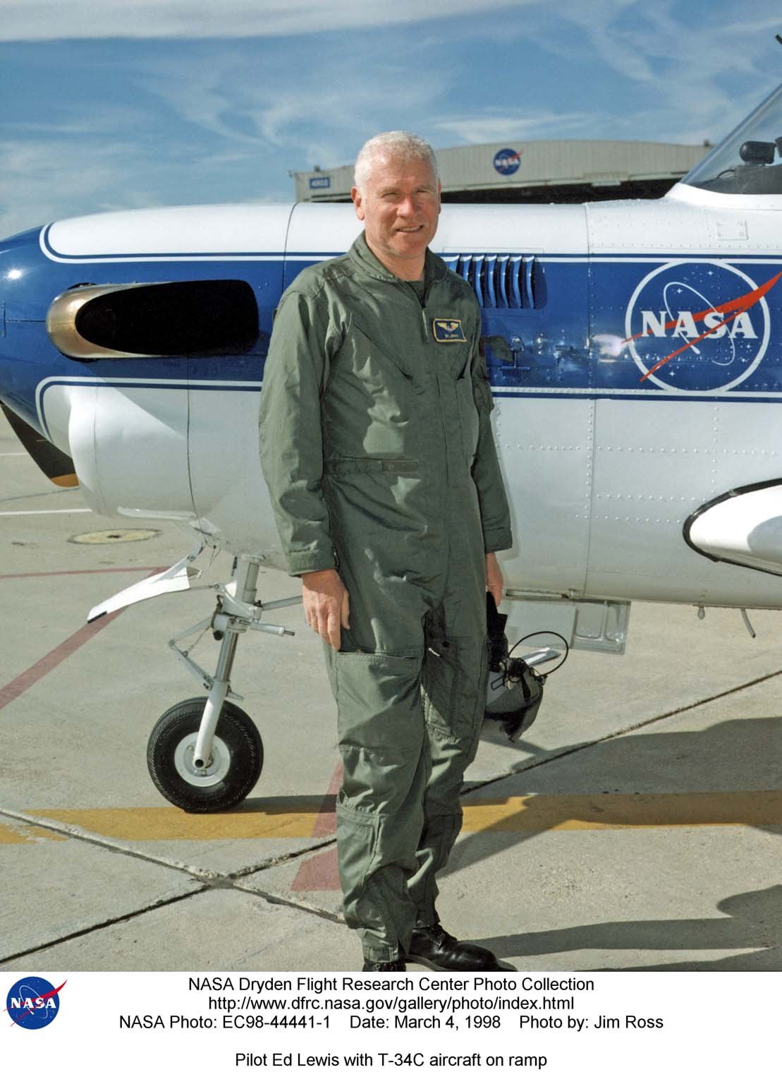 NASA pilot Ed Lewis with the T-34C aircraft on the Dryden Flight Research Center Ramp. The aircraft was previously used at the Lewis Research Center in propulsion experiments involving turboprop engines, and was used as a chase aircraft at Dryden for smaller and slower research projects. Chase aircraft accompany research flights for photography and video purposes, and also as support for safety and research. At Dryden, the T-34 is used mainly for smaller remotely piloted vehicles which fly slower than NASA's F-18's, used for larger scale projects. This aircraft was returned to the U.S. Navy in May of 2002.