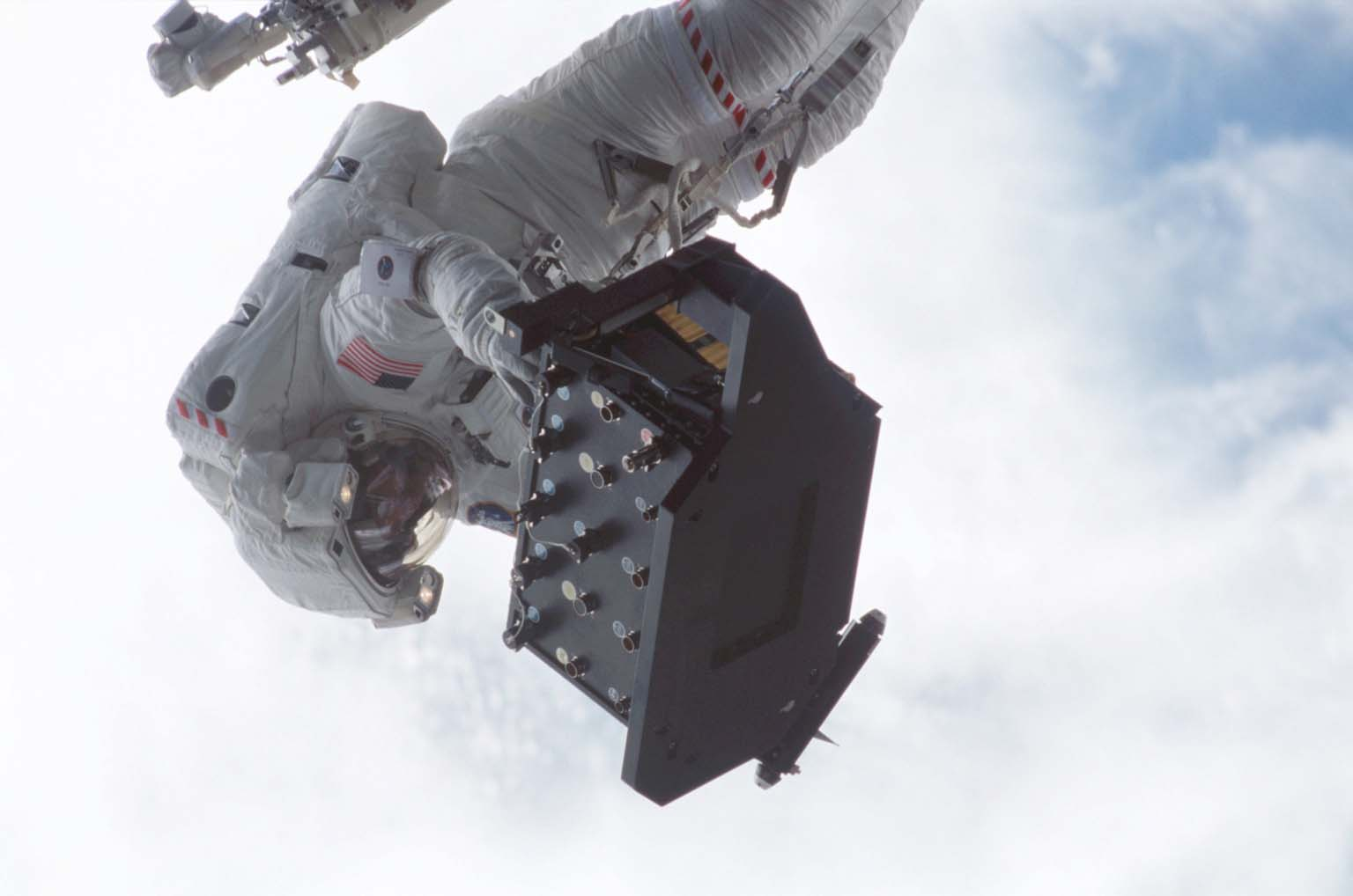 STS-109 Astronaut Michael J. Massimino Carries the Electronic Support Module (ESM)